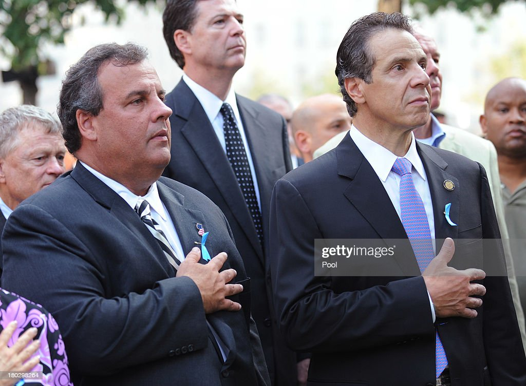 New Jersey Gov. Chris Christie (L) and New York Gov. Andrew Cuomo (R) hold their hands over thier hearts at the 9/11 Memorial during ceremonies for the twelfth anniversary of the terrorist attacks on lower Manhattan at the World Trade Center site on September 11, 2013 in New York City. The nation is commemorating the anniversary of the 2001 attacks which resulted in the deaths of nearly 3,000 people after two hijacked planes crashed into the World Trade Center, one into the Pentagon in Arlington, Virginia and one crash landed in Shanksville, Pennsylvania. Following the attacks in New York, the former location of the Twin Towers has been turned into the National September 11 Memorial & Museum.