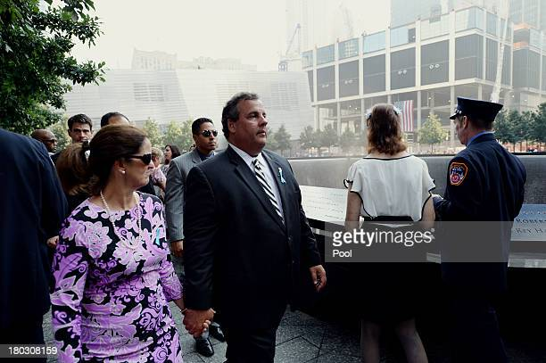 New Jersey Gov Chris Christie and wife Mary Pat Foster walk along the South Tower reflecting pool at the 9/11 Memorial during ceremonies marking the...