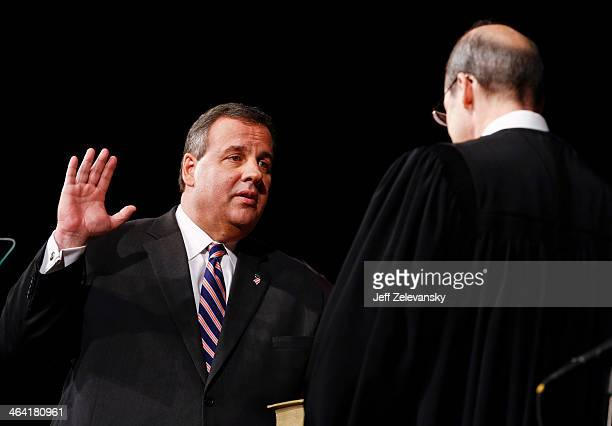 New Jersey Gov Chris Christie is sworn in by Chief Justice of the New Jersey Supreme Court Stuart Rabner for his second term on January 21 2014 at...