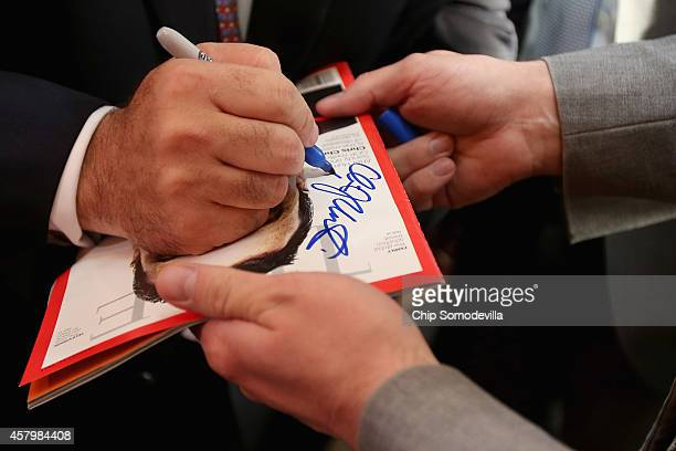 New Jersey Gov Chris Christie signs the cover of a copy of Time magazine while campaigning with Maryland Republican gubernatorial candidate Larry...