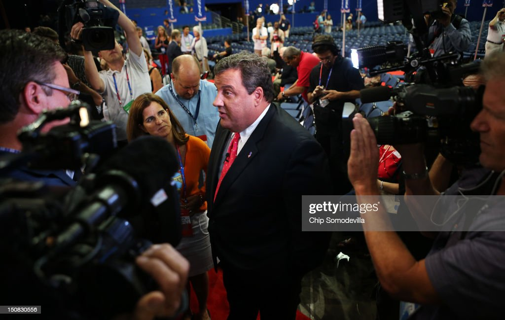 New Jersey Gov. <a gi-track='captionPersonalityLinkClicked' href=/galleries/search?phrase=Chris+Christie&family=editorial&specificpeople=6480114 ng-click='$event.stopPropagation()'>Chris Christie</a> speaks to the media on the floor before the start of the abbreviated first day of the Republican National Convention at the Tampa Bay Times Forum on August 27, 2012 in Tampa, Florida. The RNC is scheduled to convene today, but will hold its first full session tomorrow after being delayed due to Tropical Storm Isaac.