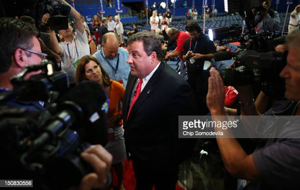 New Jersey Gov Chris Christie speaks to the media on the floor before the start of the abbreviated first day of the Republican National Convention at...