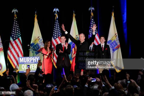 New Jersey Govelect Phil Murphy celebrates at an electionnight rally November 7 2017 in Asbury Park New Jersey Murphy was projected an early winner...