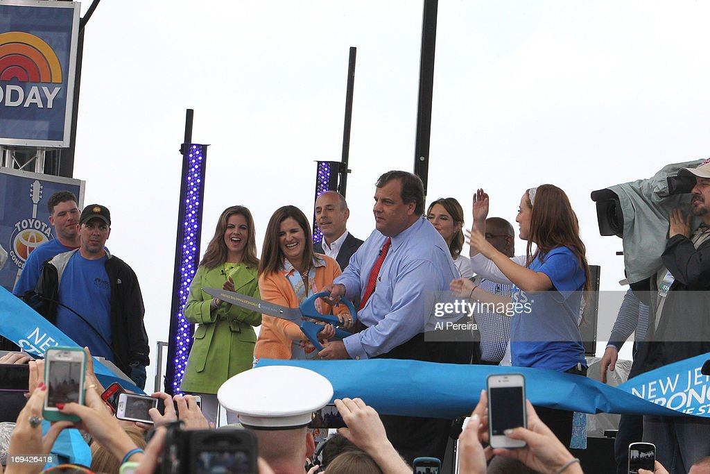 New Jersey Govenor Chris Christie cuts a giant ribbon to reopen the Jersey Shore when the music group fun. performs on NBC's 'Today'on the beach at the Seaside Heights Boardwalk on May 24, 2013 in Seaside Heights, New Jersey.