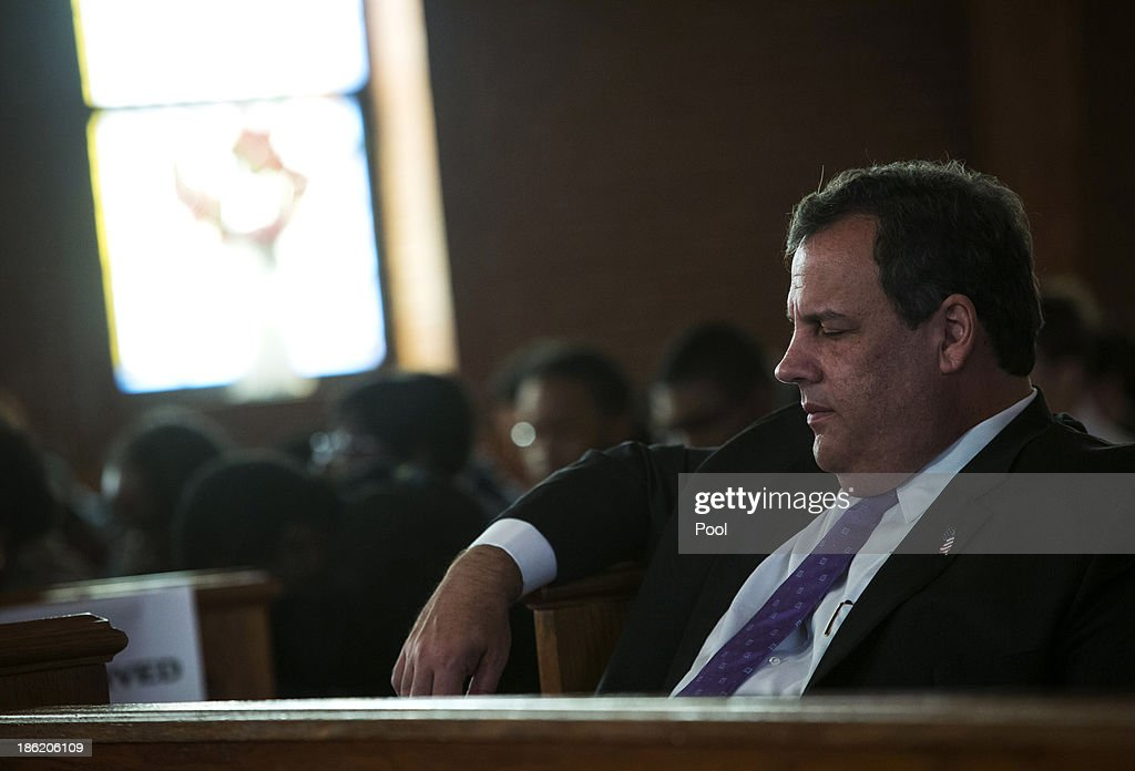 New Jersey Governor <a gi-track='captionPersonalityLinkClicked' href=/galleries/search?phrase=Chris+Christie&family=editorial&specificpeople=6480114 ng-click='$event.stopPropagation()'>Chris Christie</a> attends a statewide prayer service at the New Hope Baptist Church on the one-year anniversary of Superstorm Sandy on October 29, 2013 in Newark, New Jersey. Hurricane Sandy made landfall on October 29 near Brigantine, New Jersey and affected 24 states from Florida to Maine and cost the country an estimated $65 billion.