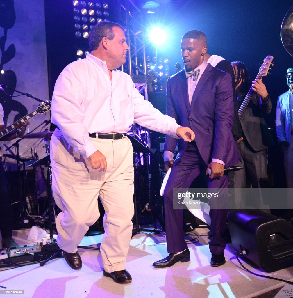 New Jersey Governor <a gi-track='captionPersonalityLinkClicked' href=/galleries/search?phrase=Chris+Christie&family=editorial&specificpeople=6480114 ng-click='$event.stopPropagation()'>Chris Christie</a> dances onstage with <a gi-track='captionPersonalityLinkClicked' href=/galleries/search?phrase=Jamie+Foxx&family=editorial&specificpeople=201715 ng-click='$event.stopPropagation()'>Jamie Foxx</a> at Apollo in the Hamptons at The Creeks on August 16, 2014 in East Hampton, New York.