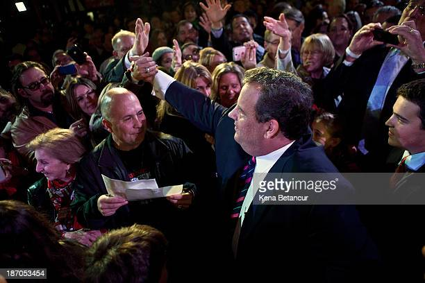 New Jersey Governor Chris Christie greets supporters after winning a second term at the Asbury Park Convention Hall on November 05 2013 in Asbury...