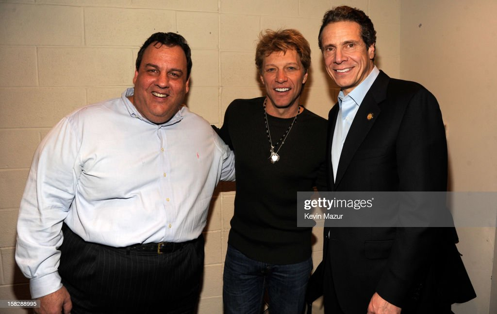 New Jersey Governor Chris Christie, Jon Bon Jovi and New York Governor Andrew Cuomo backstage during '12-12-12' a concert benefiting The Robin Hood Relief Fund to aid the victims of Hurricane Sandy presented by Clear Channel Media & Entertainment, The Madison Square Garden Company and The Weinstein Company>> at Madison Square Garden on December 12, 2012 in New York City.