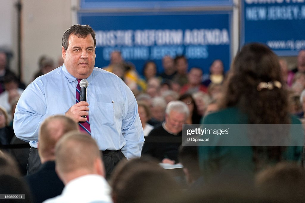 New Jersey Governor <a gi-track='captionPersonalityLinkClicked' href=/galleries/search?phrase=Chris+Christie&family=editorial&specificpeople=6480114 ng-click='$event.stopPropagation()'>Chris Christie</a> listens to a question during his 100th Town Hall Meeting at St. Mary's Parish Center on January 16, 2013 in Manahawkin, New Jersey.