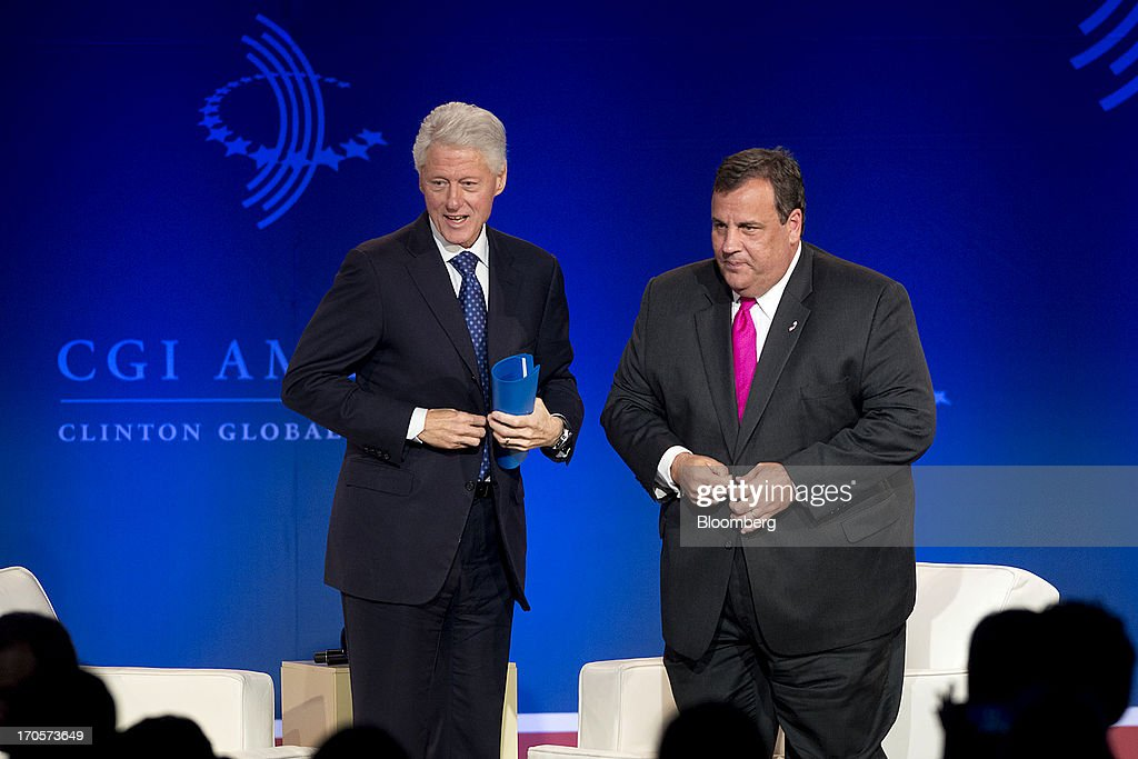 New Jersey governor <a gi-track='captionPersonalityLinkClicked' href=/galleries/search?phrase=Chris+Christie&family=editorial&specificpeople=6480114 ng-click='$event.stopPropagation()'>Chris Christie</a>, right, prepares to exit the stage after speaking with former U.S. President <a gi-track='captionPersonalityLinkClicked' href=/galleries/search?phrase=Bill+Clinton&family=editorial&specificpeople=67203 ng-click='$event.stopPropagation()'>Bill Clinton</a> during the Clinton Global Initiative CGI America meeting in Chicago, Illinois, U.S., on Friday, June 14, 2013. Christie and Democrat Hillary Clinton, both potential presidential candidates will be able to use the forum to test policy messages in front of an audience of U.S. mayors and other civic and business leaders. Photographer: Daniel Acker/Bloomberg via Getty Images