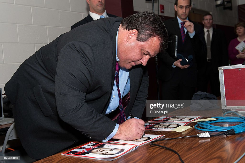 New Jersey Governor Chris Christie signs autographs after his 100th Town Hall Meeting at St. Mary's Parish Center on January 16, 2013 in Manahawkin, New Jersey.