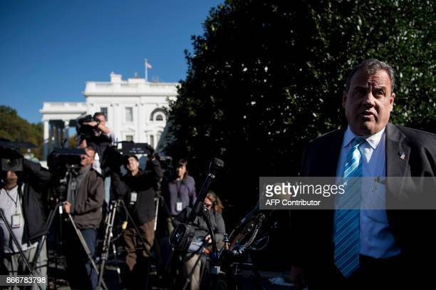 New Jersey Governor Chris Christie speaks to reporters outside the White House in Washington DC on October 26 2017 / AFP PHOTO / Brendan Smialowski