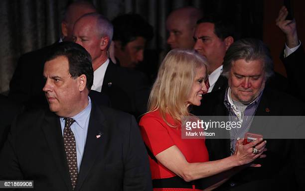 New Jersey Governor Chris Christie stands on stage along with Republican presidentelect Donald Trump's campaign manager Kellyanne Conway and Trump...