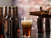 USA, New Jersey, Hand pouring beer