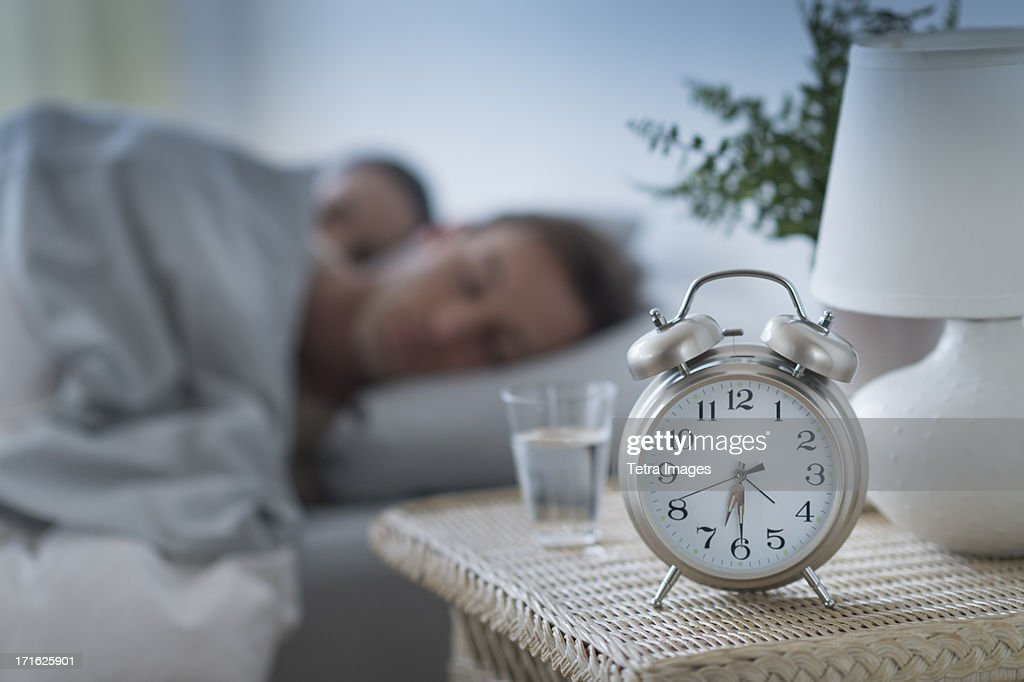 USA, New Jersey, Jersey City, Alarm Clock In Bedroom : Stock Photo
