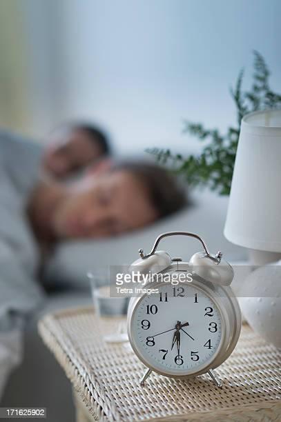 USA, New Jersey, Jersey City, Alarm clock in bedroom