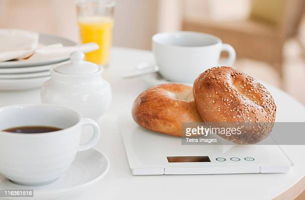 USA, New Jersey, Jersey City, bagels on weight scale on kitchen table