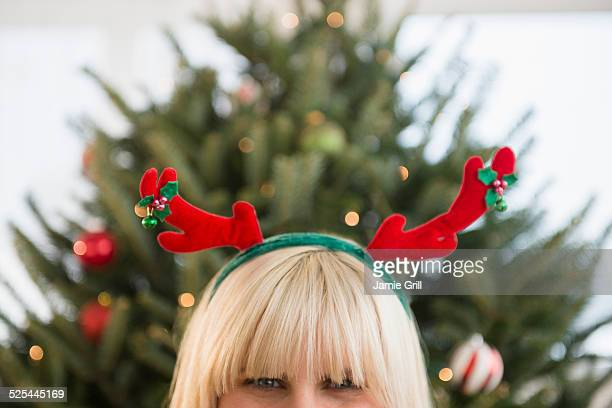 USA, New Jersey, Jersey City, Blond woman wearing reindeer headband