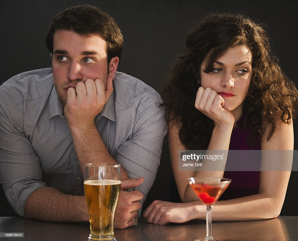 USA, New Jersey, Jersey City, Bored couple sitting at bar counter : Stock Photo