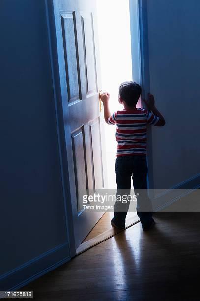 USA, New Jersey, Jersey City, Boy (4-5) peeking through doorway