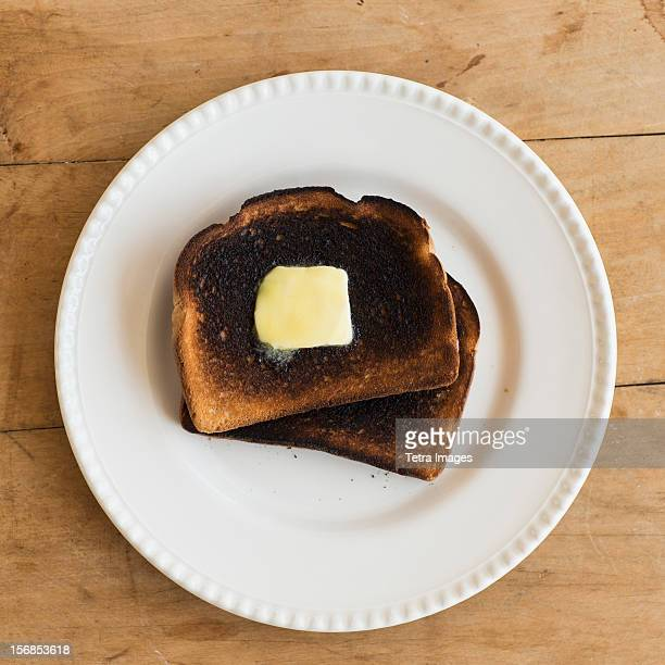 USA, New Jersey, Jersey City, Burnt toasts on plate