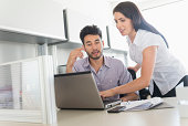 USA, New Jersey, Jersey City, Business man and woman at work in office