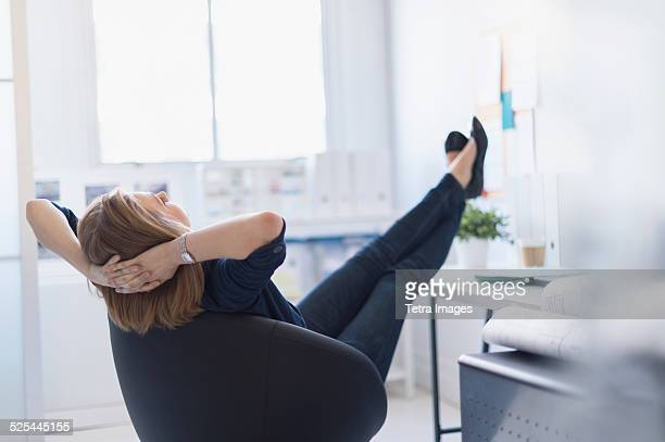 USA, New Jersey, Jersey City, Business woman relaxing in office