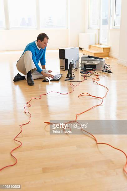 USA, New Jersey, Jersey City, Businessman setting up internet in new office