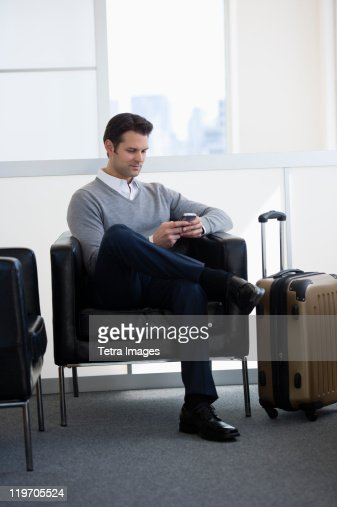 USA, New Jersey, Jersey City, businessman sitting in airport lounge