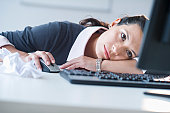 USA, New Jersey, Jersey City, Businesswoman in front of computer, looking tired