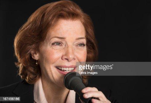 USA, New Jersey, Jersey City, Businesswoman performing speech : Stock Photo