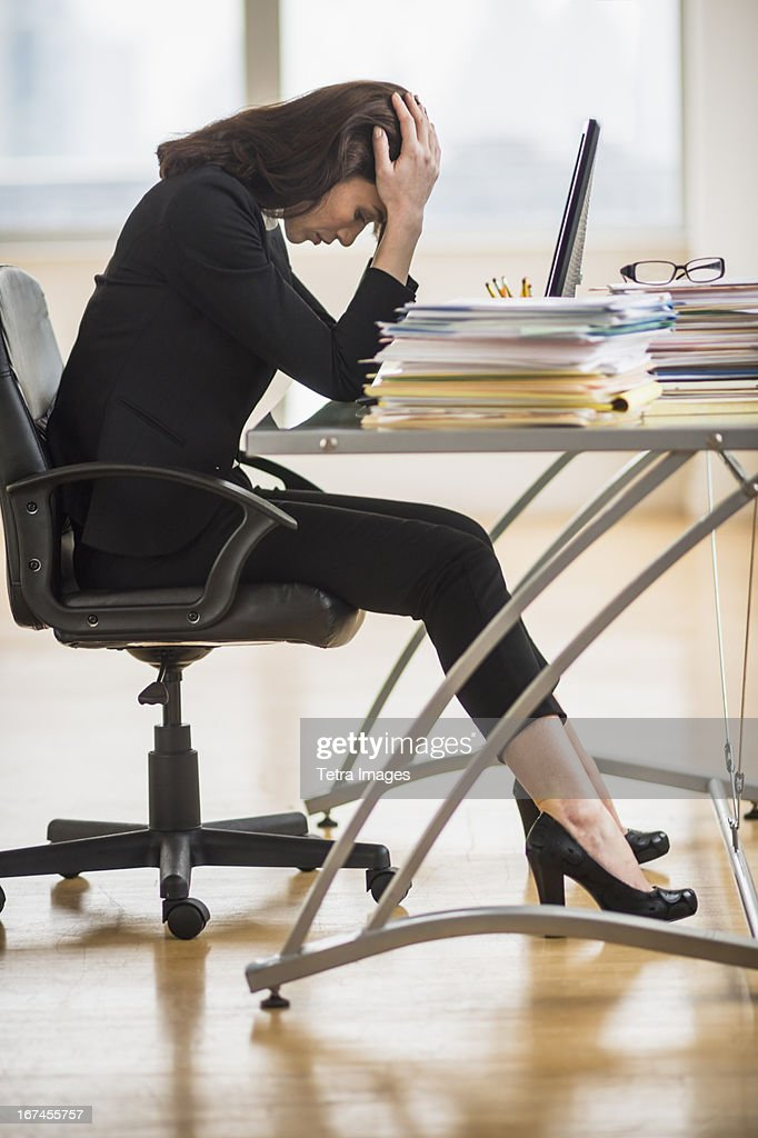 USA, New Jersey, Jersey City, Businesswoman with head in hands : Stock Photo