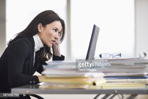 USA, New Jersey, Jersey City, Businesswoman working in office : Stock Photo