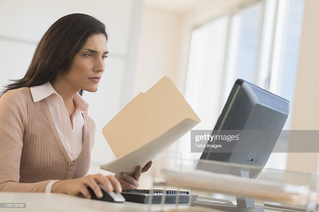 USA, New Jersey, Jersey City, Businesswoman working on computer : Stock Photo