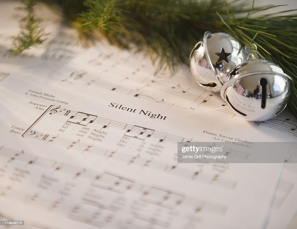 USA, New Jersey, Jersey City, Christmas baubles on carol music sheet
