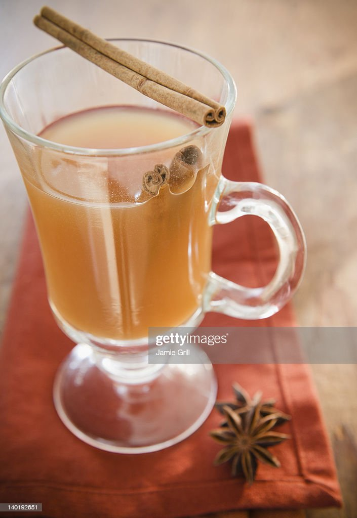 USA, New Jersey, Jersey City, Close up of apple cider with cinnamon in glass