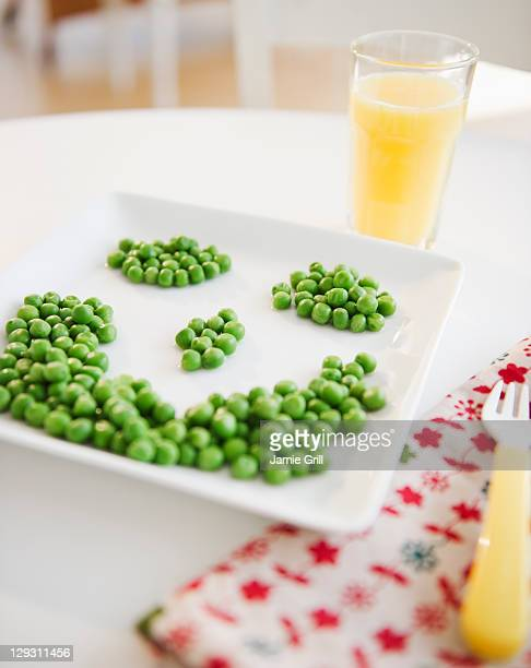 USA, New Jersey, Jersey City, Close up of smiley on plate made of green peas