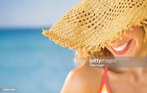 USA, New Jersey, Jersey City, Close up of smiling woman in sun hat