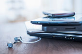 USA, New Jersey, Jersey City, Close up of stack of devices on desk