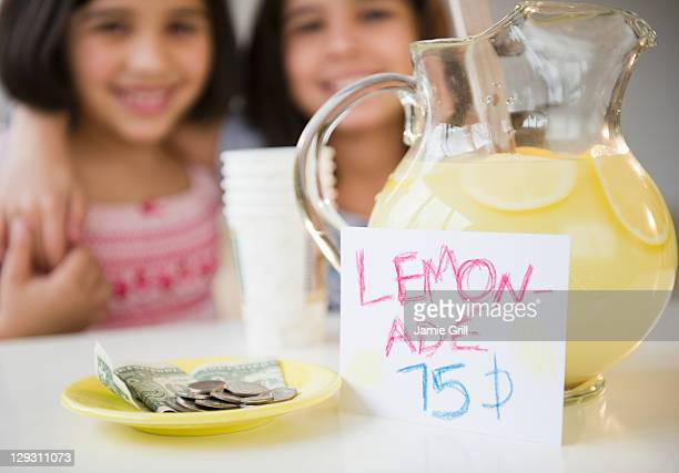 USA, New Jersey, Jersey City, Close up of two girl's (8-9, 10-11) selling lemonade