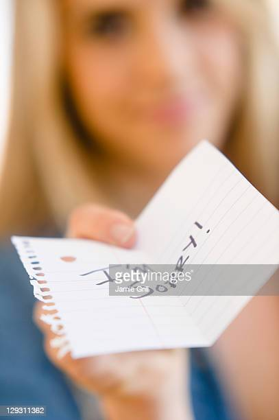 USA, New Jersey, Jersey City, Close up of woman showing apologize message