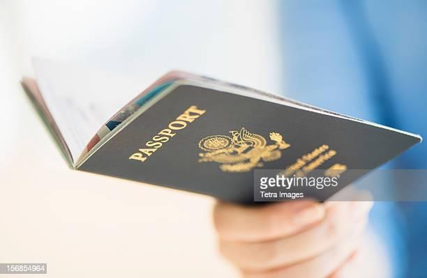 USA, New Jersey, Jersey City, Close up of woman's hand holding open passport