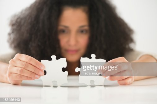 USA, New Jersey, Jersey City, Close up of woman's hands matching jigsaw puzzle : Stock Photo