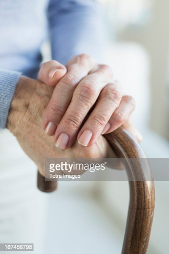 USA, New Jersey, Jersey City, Close-up of hands of grandmother and granddaughter (16-17)