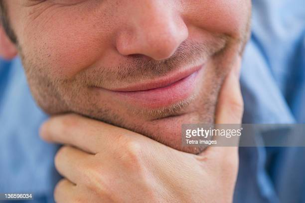 USA, New Jersey, Jersey City, Close-up of young man with hand on chin