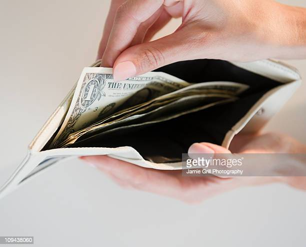 USA, New Jersey, Jersey City, Close-up view of pulling one dollar note from wallet
