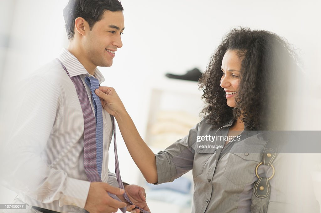 USA, New Jersey, Jersey City, Couple buying tie : Stock Photo