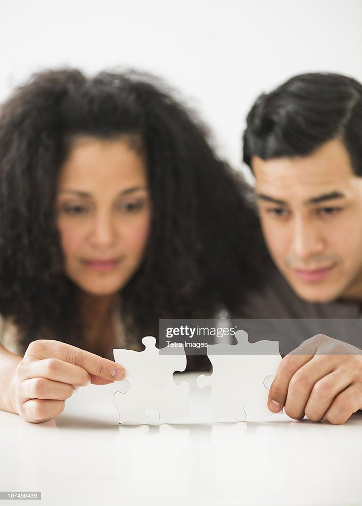 USA, New Jersey, Jersey City, Couple matching jigsaw puzzle : Stock Photo
