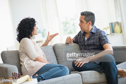 USA, New Jersey, Jersey City, Couple talking on sofa