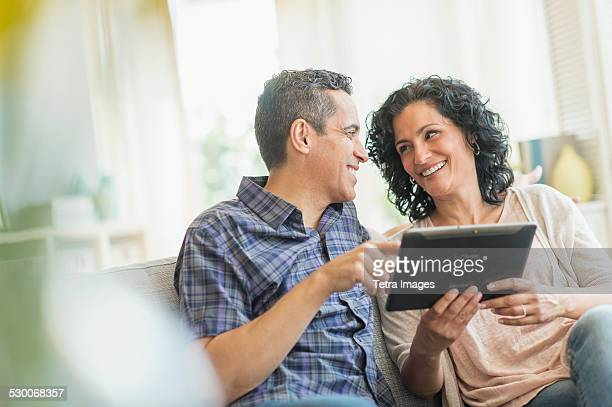 USA, New Jersey, Jersey City, Couple using digital tablet